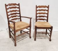 Set of five 20th century oak ladderback rush-seated chairswith turned stretchers (5)