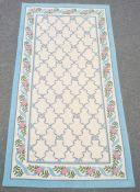 Three modern rugs, cream ground with blue ribbon trellis decoration, various sizes