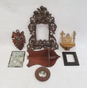 Metal ornate photograph framewith cherub surmount, carved treenand other items