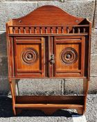 James Shoolbred of London wall-hanging cabinet, the arched back above spindle turned gallery, two