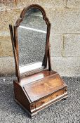 Early 18th century style walnut and banded dressing table mirror, the arched-top mirror on box