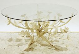 Modern coffee tablewith glass top and Italian-style cream painted floral spray base, 85cm diameter
