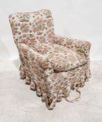 Late Victorian armchairin cream ground loose covers, on square section tapering front legs to brown