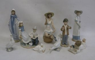 Quantity of Nao figures to includeboy bandaging girl's foot, Edwardian-style lady, girl seated on