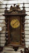 Wall clock surmounted by eagle, Roman numerals