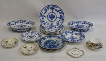 Two old Delft plates, blue and white decorated with floral and fence-pattern to the centre, stylised