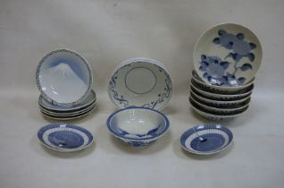 Various modern Oriental blue and white plates and bowls, floral decorated, mountain decorated, fan