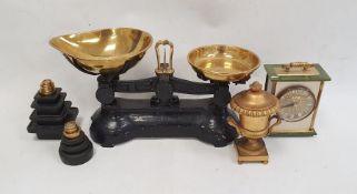 Set of vintage kitchen scales, set of weights, modern mantle clock andgilt metal lidded urn