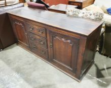 18th century oak low dresser, the rectangular top above three graduated short drawers flanked by