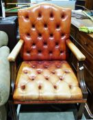 Buttonback office chairin red leather, moulded shew and mahogany frame