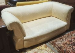 Late Victorian Chesterfield drop-arm sofa in pale yellow diamond patterned upholstery, turned