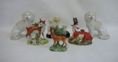 Staffordshire pottery deer, another stag, aspaniel group, a stag with bocage and a pair of china