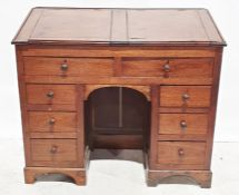 19th century mahogany clerk's kneehole desk, the top with two lift-up compartments above eight