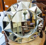 Three assorted mirrorsincluding rectangular mirror with moulded silver-coloured frame (3)