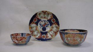 Imari porcelain plaque, circular and ribbed, 52cm diameter, an Imari porcelain bowl, fluted and with