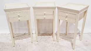 Set of three 20th century side tableswith cream-painted tray tops, two drawers, on square section