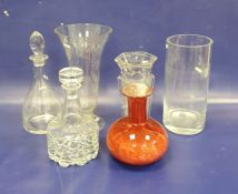 Two modern glass decanters, two large vases, a heavy hexagonal glass vaseand a red mottled glass