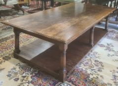 20th century rectangular oak coffee table on turned and block supports, shelved undertier, 47cm x