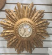 20th century Smiths sunburst clock, in gold coloured moulded frame, 45 cm approx