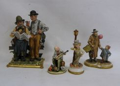 Capodimonte figure group, two tramps reading newspaper, another of man with child and balloon,