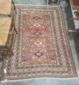 Red ground Eastern-style rug with stepped border 170cm x 127 cmCondition ReportExtra photos added