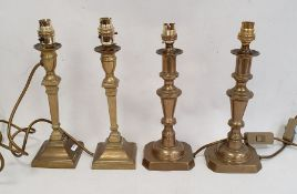 Two pairs of brass candlestick-style table lamps(4)