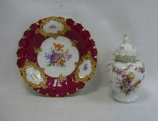 Circular floral and gilt decorated dishwith blue cross swords mark to reverse, 30cm high and a