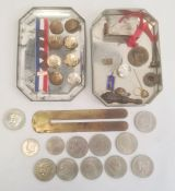 Vintage tincontaining various military buttons and assorted coins in clear plastic bag (2)