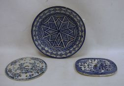 Two blue and white meat drainers, one marked 'Reed' to reverse and a possibly Middle Eastern blue
