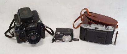 Voigtlander Bessa 1 folding camera, a Zenit 11 camera and other camera items