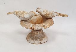 White painted cast metal doves on urn ornament, 21cm high