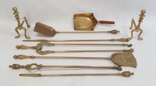 Quantity brass fireside implementsincluding tongs, pair brass fire dogs and a shovel