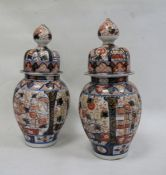 Pair Japanese Imari vases, each ovoid and ribbed with typical decoration in panels, having high