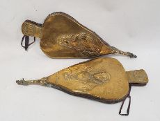 Two pairs of brass and oak bellows with embossed decoration featuring Charles the first and the