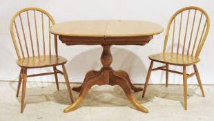 Modern Ercol elm-topped extending dining tableand four elm-seated Ercol chairs(5)
