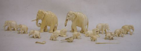 Collection of carved ivory elephants, lions, etc, graduated, largest 8.5cm high (1 box)