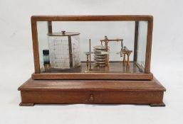 Stained wood and glazed cased barographwith single shelf, on sledge feet