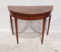 19th century mahogany and banded demi-lune fold-over card table on square section tapering supports,