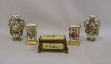 Pair of 19th century china floral encrusted vases, baluster-shaped with scrolled and looped handled,