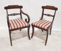 Set of eight (six plus two carvers) Regency mahogany dining chairs, carved top rails, and reeded