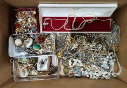 Quantity of costume jewelleryto include brooches, clip-on earrings, beaded necklaces, etc (1 box)