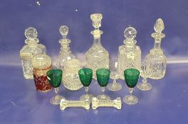 Five various decanters, four green and clear etched stemmed wineswith floral swag decoration, two