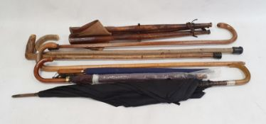 Shooting stick, quantity walking sticksand vintage umbrellas