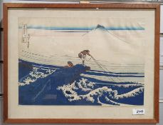 Japanese woodblock colour print depicting fishermen with Mount Fuji in the background together