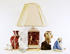 Nao model of a swan, two Nao modelsof ducklings, a sculpture of an owl, a modern ceramic table