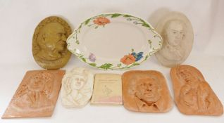 Two pottery wall plaques, one of Thomas Hardy, the other of R B Sheridan, together with various