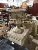 Stone urn on a plinth base together with two further stone urns (3)