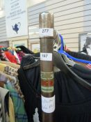 Dress rail labelled 'Yugin, London, W1', 166cm high x 114cm wide Please note the lot number 277