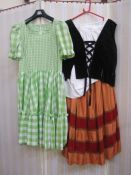 Quantity of assorted theatrical costumeto include Gingham milkmaid-style dresses, velvet,