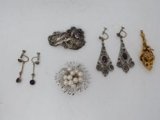 A collection of costume jewellery. Including a cultured pearl and silver floral design brooch, a